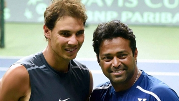 Spain's Rafael Nadal and India's Leander Paes pose for photographs during a practice session in New Delhi. (Photo: PTI)