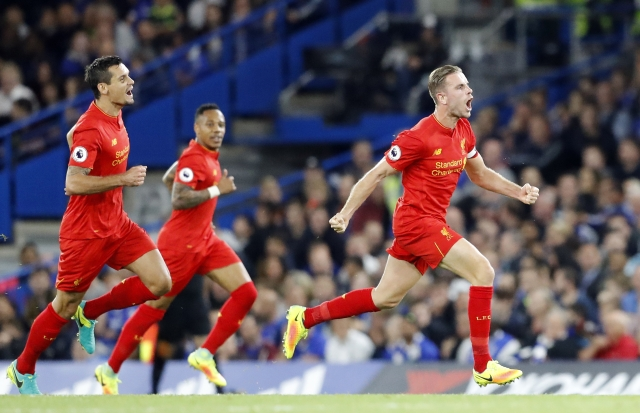 Jordan Henderson celebrates after scoring his side's second goal. (Photo: AP)