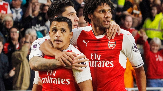 Alexis Sanchez celebrates a goal with his teammates. (Photo: AP)