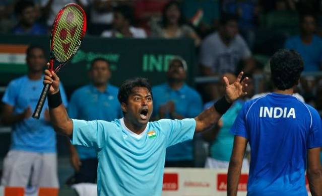 India's Leander Paes, left, celebrates a point with teammate Saketh Myneni. (Photo: AP)
