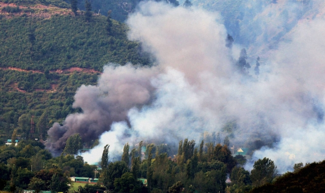 Smoke rises from the army brigade camp in Uri. (Photo: PTI)