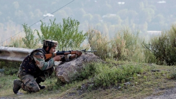 An Indian soldier takes position near Army Brigade camp during a terror attack in Uri, Jammu and Kashmir on Sunday. (Photo: PTI)