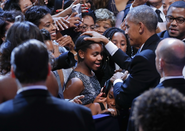 President Obama pats two young girls on the head as he greets guests after speaking at the Congressional Black Caucus Foundation's annual Legislative Conference Phoenix Awards Dinner, 17 September 2016, Washington. (Photo: AP)