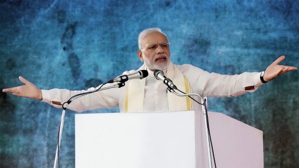 Prime Minister Narendra Modi addressing a public rally at the BJP National council meeting at Kozhikode, 24 September, 2016. (Photo: PTI/ Altered by <b>The Quint</b>)