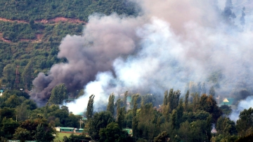 Smoke billows out of Uri army camp that was attacked by terrorists on 18 Sept, 2016. (Photo: IANS)