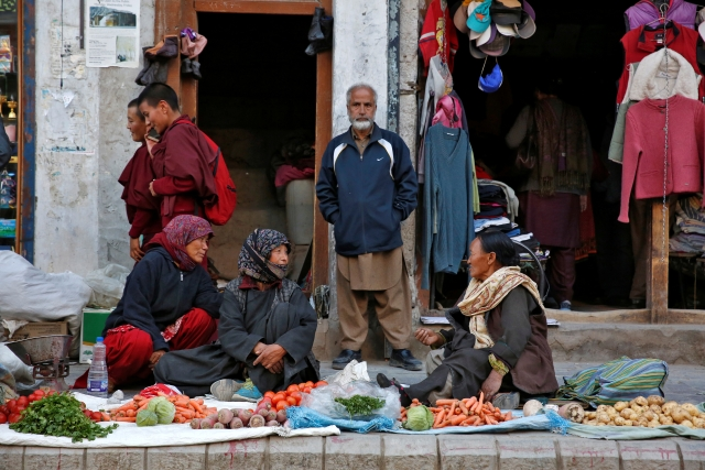 Vegetable vendors chat in Leh, the largest town in the region of Ladakh, nestled high in the Indian Himalayas. (Photo: Cathal McNaughton)