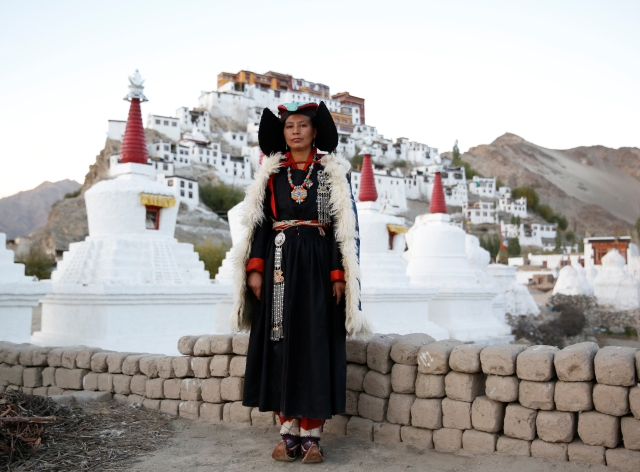 Phunchok Angmo, 33, a mathematics teacher, poses for a photograph at Thiksey monastery, near Leh, the largest town in the region of Ladakh. (Photo: Cathal McNaughton)