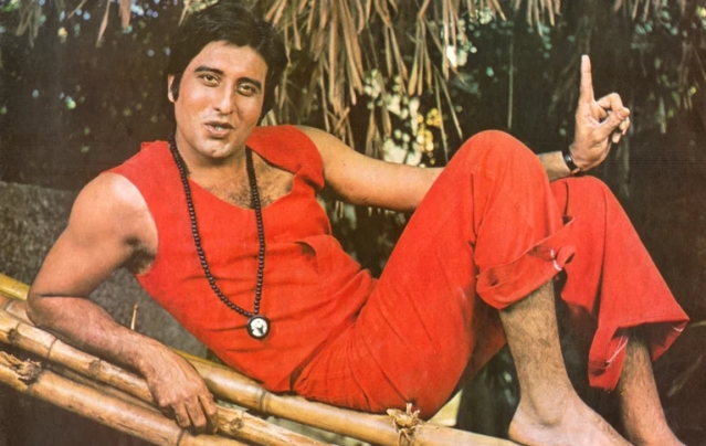 Vinod Khanna in orange and and the beaded necklace.