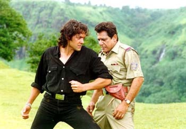Om Puri and Bobby Deol in a still from <i>Gupt</i>.