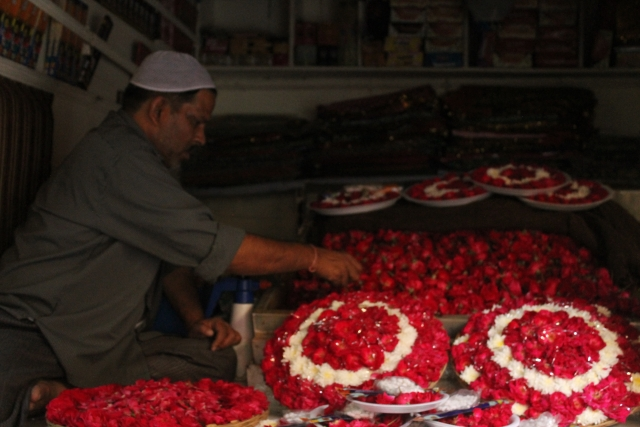 A flower seller out the dargah of Khwaja Bhaktiar. (Photo: Shorbori Purkayastha)