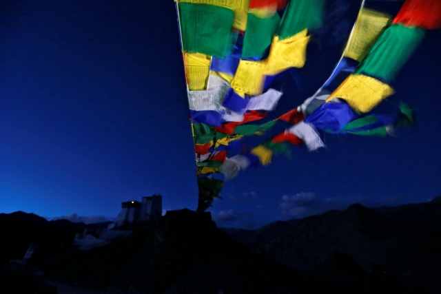 Prayer flags stretch towards Tsemo Monastery in the city of Leh, the largest town in the region of Ladakh. (Photo: Cathal McNoughton)