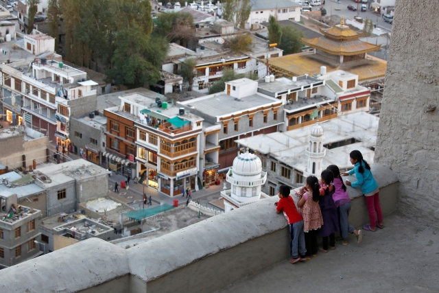 Children look down from the Royal Palace in Leh, the largest town in the region of Ladakh, nestled high in the Indian Himalayas. (Photo: Cathal McNaughton)