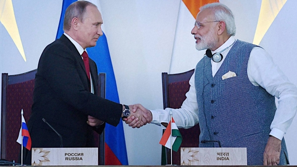 Prime Minister Narendra Modi shakes hands with Russian President Vladimir Putin at the agreement exchange ceremony after the 17th India-Russia annual summit meet in Benaulim, Goa on Saturday. (Photo: PTI)
