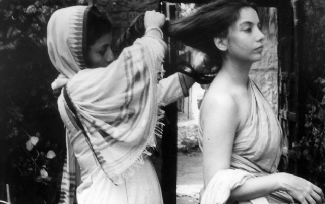 "Aparna Sen ties Shabana Azmi's hair  on the sets of Sati. (Photo courtesy: <a href=""https://twitter.com/search?f=images&vertical=default&q=aparna%20%20sen&src=typd"">Twitter/ @kishuanjali</a>)"