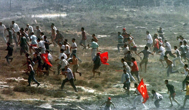 Turkish Cypriots chase Greek Cypriots during the 1974 Turkish invasion of Cyprus. (Photo: Reuters)