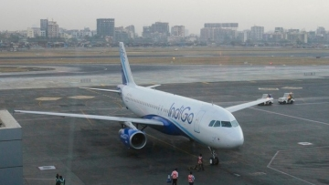 An IndiGo Airlines aircraft arrives at a gate of the domestic airport in Mumbai.