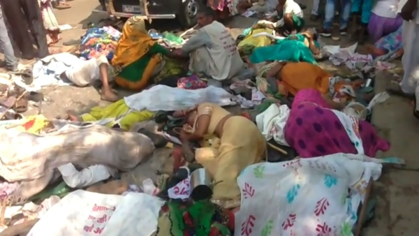 The bodies of the pilgrims who were killed in a stampede during a religious procession at the Rajghat bridge in the Ramnagar area of Varanasi on Saturday. (Photo: IANS)