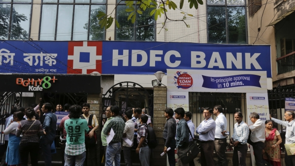 People queue up outside a branch of HDFC bank.