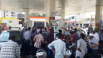 People queue up at a petrol pump in Hyderabad to fill petrol after Prime Minister Narendra Modi announced demonetisation.