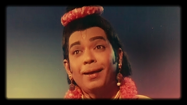 That's maestro Balamuralikrishna as Narada in the movie <i>Bhakta Prahlada</i>. He acts like he was born to play the role.&nbsp;