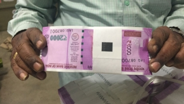 """Months before PM Modi scrapped the Rs 1,000 and Rs 500 notes, this photo of the new 2,000 rupee banknote fuelled rumours of impending monetisation. (Photo: Twitter/<a href=""""https://twitter.com/kambojOffice/status/795134459037163520/photo/1?ref_src=twsrc%5Etfw"""">@kambojOffice</a>)"""