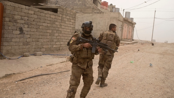 File image of Iraqi special forces soldiers try to find cover as they take fire from ISIS militants.
