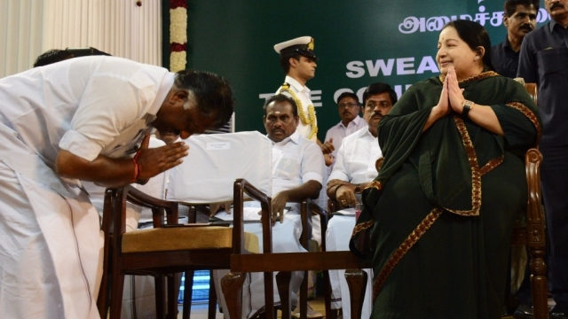 O Panneerselvam bows down before his leader,  AIADMK supremo  J Jayalalithaa, during her swearing-in ceremony as Tamil Nadu chief minister  in Chennai,   23 May, 2016. (File Photo: IANS)