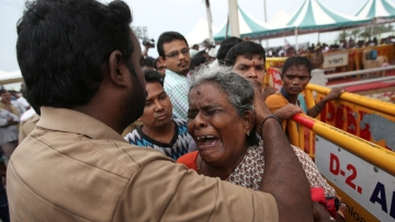 A supporter of J Jayalalithaa breaks down during her funeral. (Photo: Reuters)