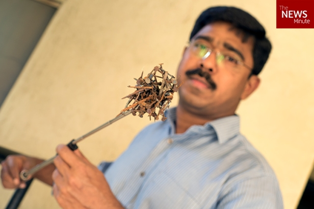 "Bengaluru-based Benedict Jebakumar has been combing the road between his home and his office for the past four years. (Photo Courtesy: <a href=""http://www.thenewsminute.com/article/how-one-man-collected-70kg-nails-roads-save-your-tyres-puncture-mafia-54823"">The News Minute</a>)"