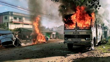 Angry mobs set vehicles on fire in Imphal East district on Sunday in protest against the United Naga Council (UNC)'s indefinite economic blockade. (Photo: PTI)