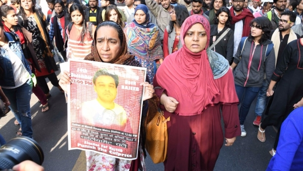 JNU students along with Najeeb Ahmed's mother, Fatima Nafees, and his sister participate in a march against Central Government and Delhi Police in New Delhi, on 14 December, 2016.