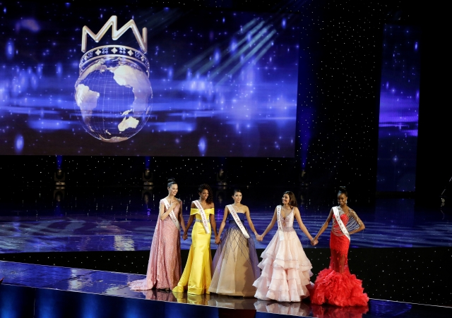 Miss Philippines Catriona Elisa Gray, Miss Dominican Republic Yaritza Miguelina Reyes Ramirez, Miss Indonesia Natasha Mannuela, Miss Puerto Rico Stephanie Del Valle and Miss Kenya Evelyn Njambi Thungu, finalists in the  competition, stand together. (Photo: Reuters)
