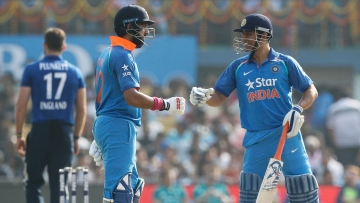 Yuvraj Singh (L) and MS Dhoni (R). (Photo: BCCI)