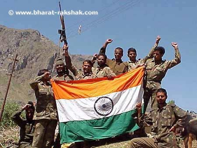 Point 4825Back in Indian hands: Jawans with the flag on Point 4825, which was being held by the enemy in the Mushkoh Valley.
