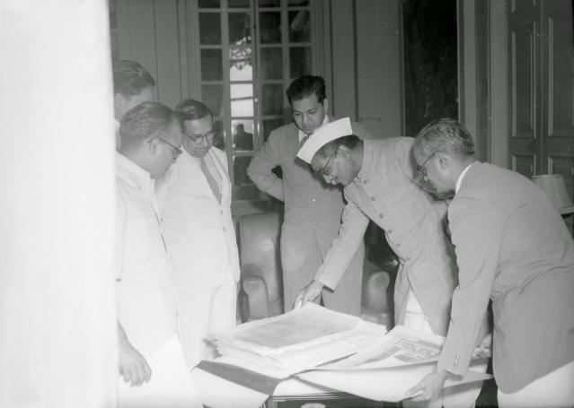 "Presentation ceremony of the Constitution of India, Prem Behari Narain Raizada showing & presenting the original manuscript to the first president of India, Rajendra Prasad. (Photo courtesy: <a href=""https://plus.google.com/photos/118092972326422169139/album/6222871843021072913/6222871841199942338?authkey=CKSmtqy8tYvLfw"">Prem Foundation</a>)"