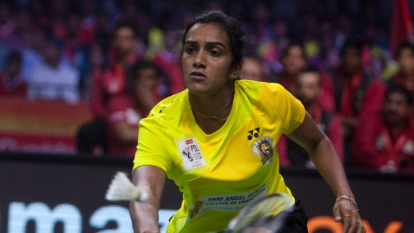 Chennai Smashers PV Sindhu returns a shot to Carolina Marin of Hyderabad Hunters during the women's singles of Premier Badminton League (PBL) in Hyderabad. (Photo: AP)
