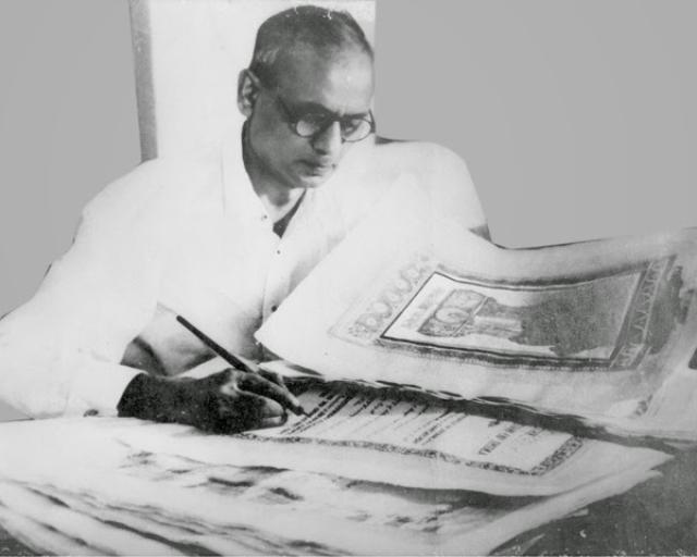 """A rare photograph of Prem Behari Raizada working on the Constitution in New Delhi. (Photo Courtesy: <a href=""""https://plus.google.com/118092972326422169139/posts/54FESBuwbDV?sfc=false"""">Prem Foundation</a>)"""