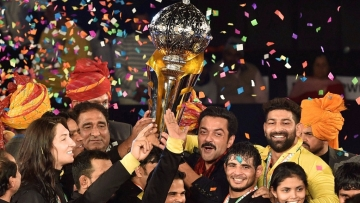 Punjab Royals' co-owner Bobby Deol and players celebrate with Pro Wrestling League Season 2 Trophy after they beat Haryana Hammers in the final. (Photo: PTI)
