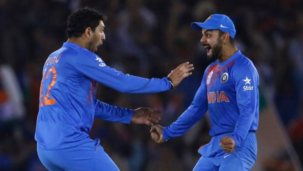 India's Yuvraj Singh (L) celebrates with his teammate Virat Kohli after taking the wicket of Australia's captain Steven Smith in a T20 match in 2016. (Photo: Reuters)