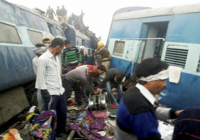 Rescue officials on the spot where 14 coaches of the Indore-Patna Express derailed. (Photo: PTI)