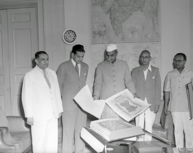 "Presentation ceremony of the Constitution of India, Prem Behari Narain Raizada showing & presenting the original manuscript to the first president of India, Rajendra Prasad. (Photo courtesy: <a href=""https://plus.google.com/photos/118092972326422169139/album/6222871843021072913/6222871841498834370?authkey=CKSmtqy8tYvLfw"">Prem Foundation</a>)"