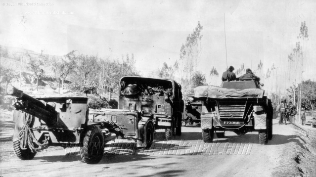 Armour and guns on the Baramulla Road, on 17 November  in the year 1947. A mechanised column of Damlier Armoured Cars and 25 Pounder Guns of the Indian Army moves along the road to Baramulla.
