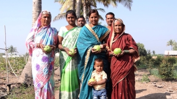 A happy VNR-Bihi grower's family in Pitkeshwar village in Pune district of Maharashtra. (Photo by VNR Nursery/ The Village Square)