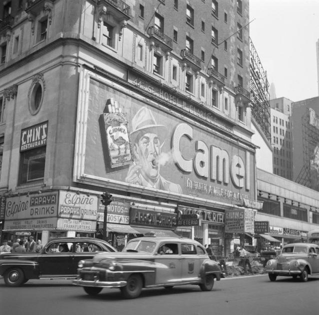 "A Camel billboard in New York's Times Square in 1948. (Photo Courtesy: <a href=""https://en.wikipedia.org/wiki/Camel_(cigarette)#/media/File:Rokend_Camel-reclamebord_Smoking_billboard.jpg"">Wikipedia</a>)"