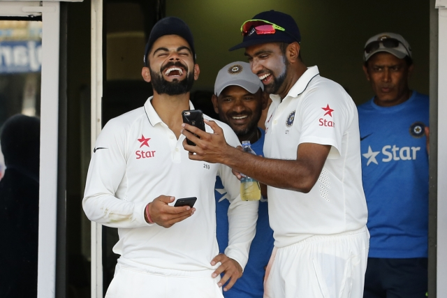 Virat Kohli (L) and Ravichandran Ashwin (R) share a light moment in the dressing room. (Photo: BCCI)