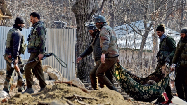 Special Operation Group (SOG) of JK police carrying the body of a militant,  recovered from the rubbles of destroyed house, after an encounter at Frisal area of Kulgam district of South Kashmir, 12 February, 2017. (Photo: PTI)