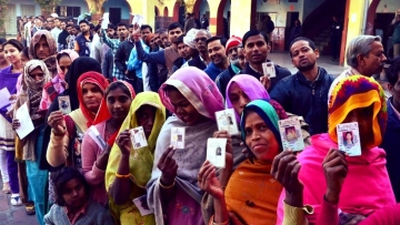 People stand in a queue to cast their vote in the first phase of the Uttar Pradesh Assembly elections in Agra on 11 February 2017. (Photo: IANS)