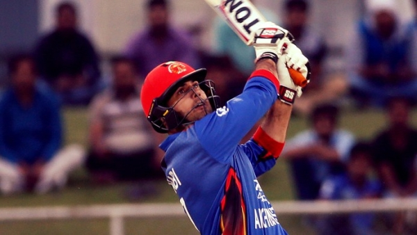 Afghanistan's Mohammad Nabi hits a six during the first ODI against Ireland in Greater Noida on Wednesday. (Photo: AP)