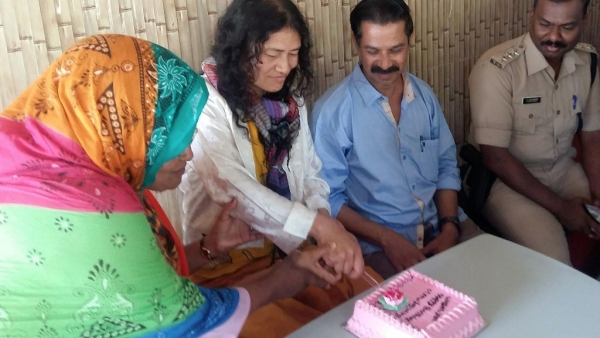 Irom Sharmila arrived in Kerala on her 45th birthday. She cut a cake with friends at the Santhigramam rehabilitation centre in Kerala. (Photo: PTI)