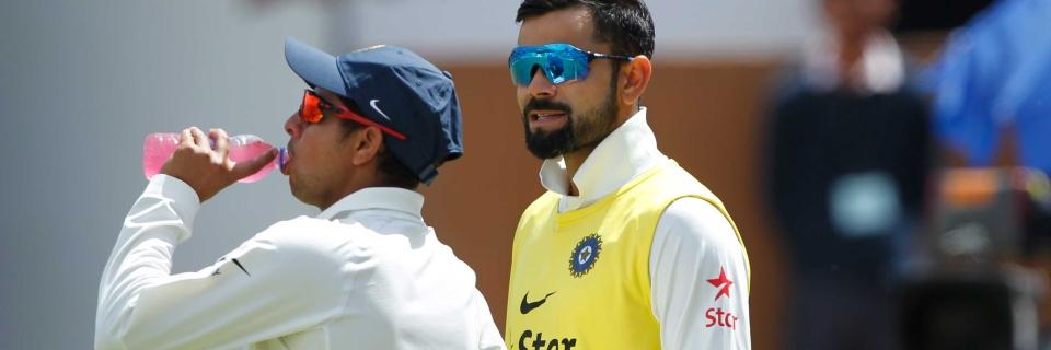 4b5a88723c0 Virat Kohli met Kuldeep Yadav on the sidelines after his first wicket.  (Photo